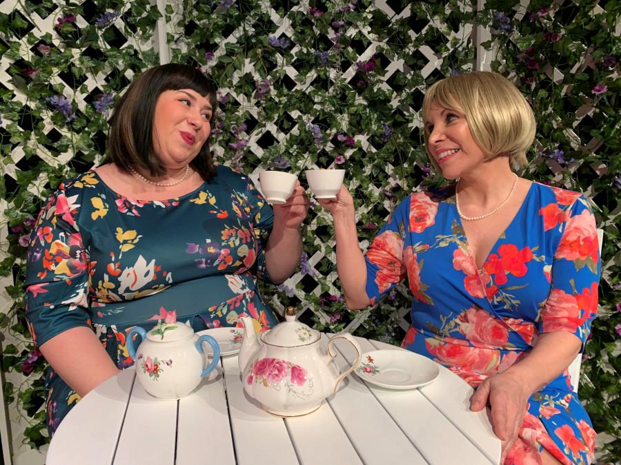 Mallory-and-Lynn-toasting-tea-garden