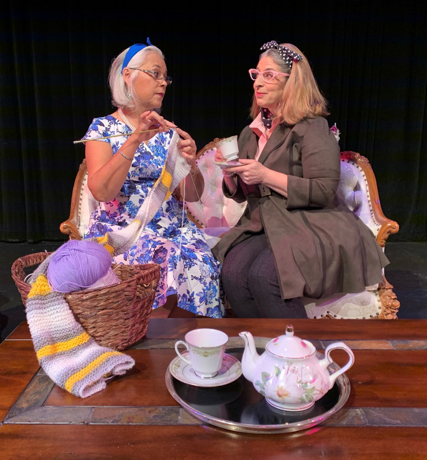 two-ladies-on-counch-knitting-and-tea